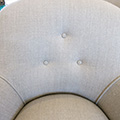 French Nursery chair. Details of buttons and linen.