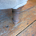 French Nursery chair. Detail of brown beechwood turned leg.