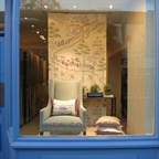 Pakefield wing back chair covered in Nina Campbell 's fabric (NCF4161-01) displayed in Osborne&L's Kings Road showroom