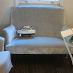 Amelie Sofa covered in a Romo blue grey oyster velvet.