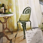 Green garden chair and accessories styled by Anna Malhomme de la Roche in Homes&Antiques march 2014.