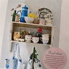 Painted shelf and accessories styled by Anna Malhomme de la Roche in Homes&Antiques march 2014.