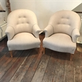 Pair of french vintage tub chairs covered in Taupe linen with sabre beechwood legs. C1950